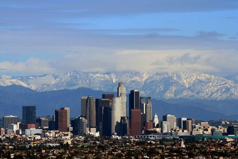 Los Angeles, CA Skyline with snow covered mountains in background