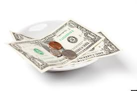 Dollar notes and coins as a sign of tips