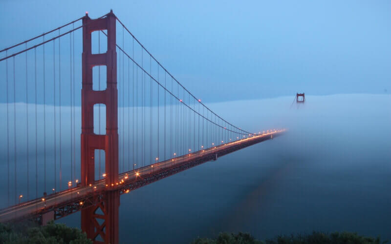 San Francisco Golden Gate bridge is covered by fog in California