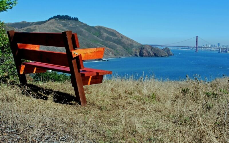 An empty bench beside lake in Marin County California