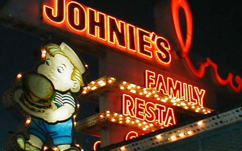 Lighted restaurant name in Downey in night